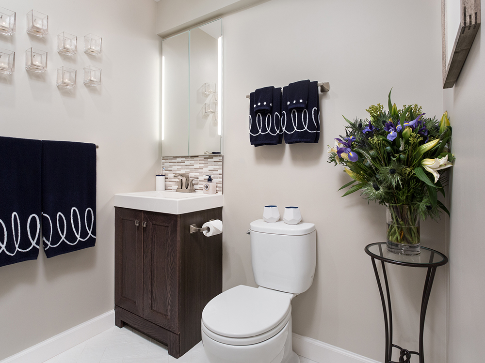 bathroom, rockville, candles, modern bathroom, brown tile, blue towels, joanne rodriguez bathroom designer